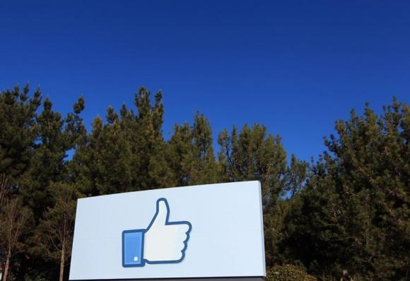 """A giant """"like"""" icon made popular by Facebook is seen at the company's new headquarters in Menlo Park"""